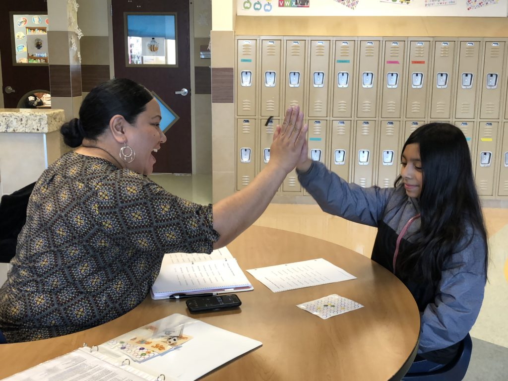Savage Volunteer high 5s Midvale student
