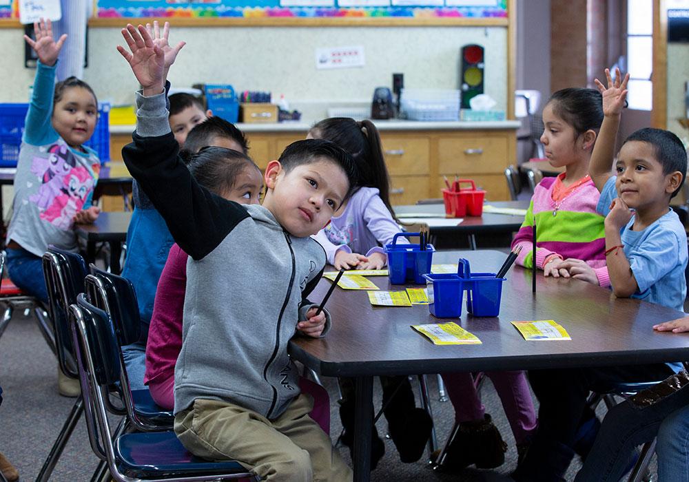 Kids raising hands