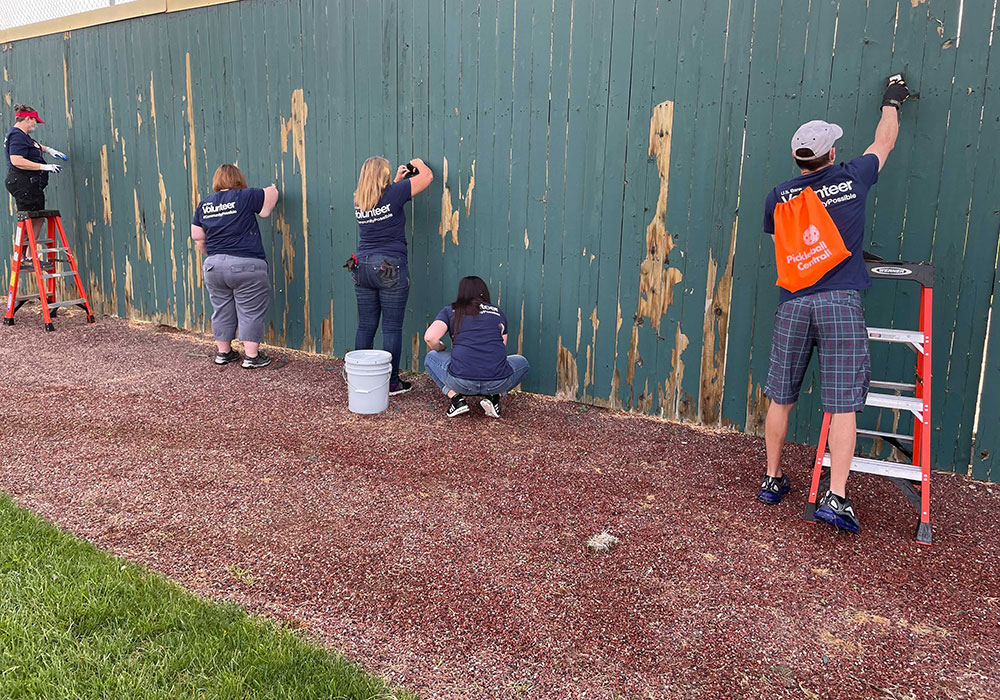 US Bank painting fence at Day of Caring